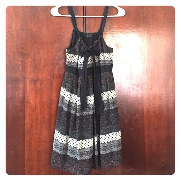 Black dress with front bow! A good girl black dress with beautiful print. Only used it once. Be cool Dresses