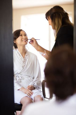 Winery Styled Wedding Shoot - The Bride in Doie Robe Getting Makeup Done