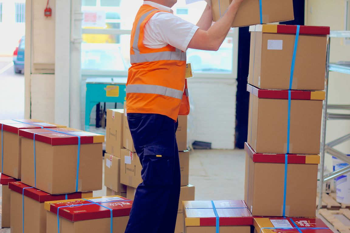 DHL Express packing happy worker job Worker, Uk