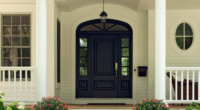A front door painted with benjamin moore s baby seal black 2119 30 instantly catches the eye - Exterior sealant paint decor ...