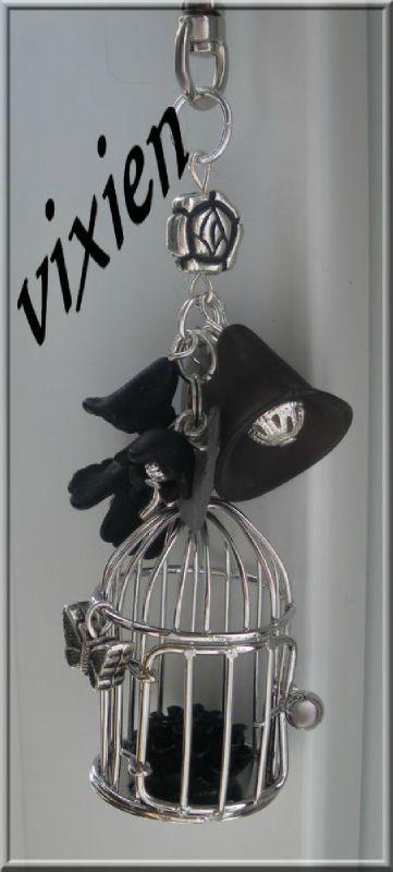 Bijou de sac Cage fleurie, noir et argent