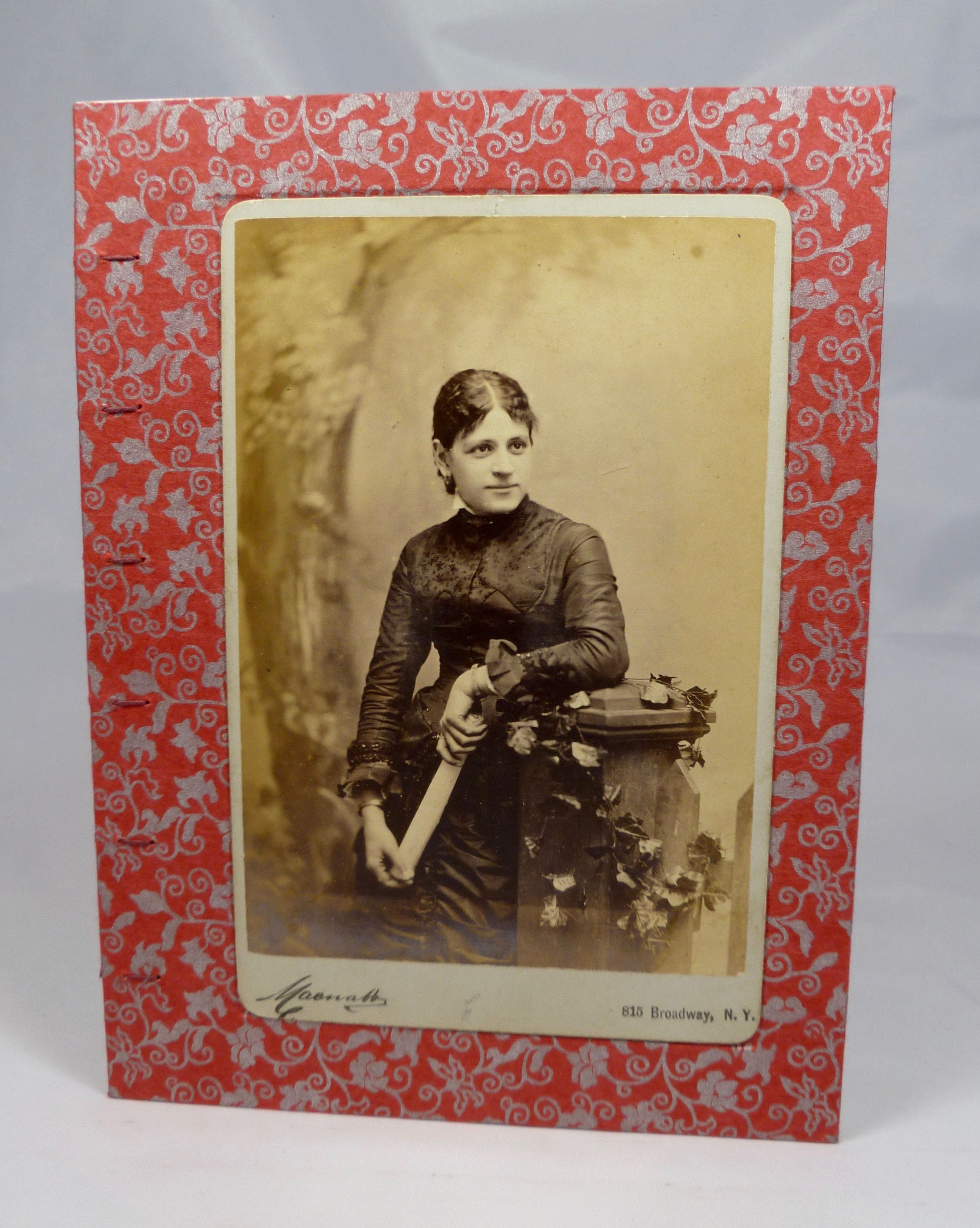 http://www.passionatobooks.com/printed-journals/vintage-photograph-of-a-seated-woman-on-cover-of-hand-sewn-journal