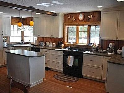 Image result for modern home with knotty pine walls | white kitchen on fireplace with white cabinets, pine walls with crown molding, pine walls with white trim, hardwood floors with white cabinets,