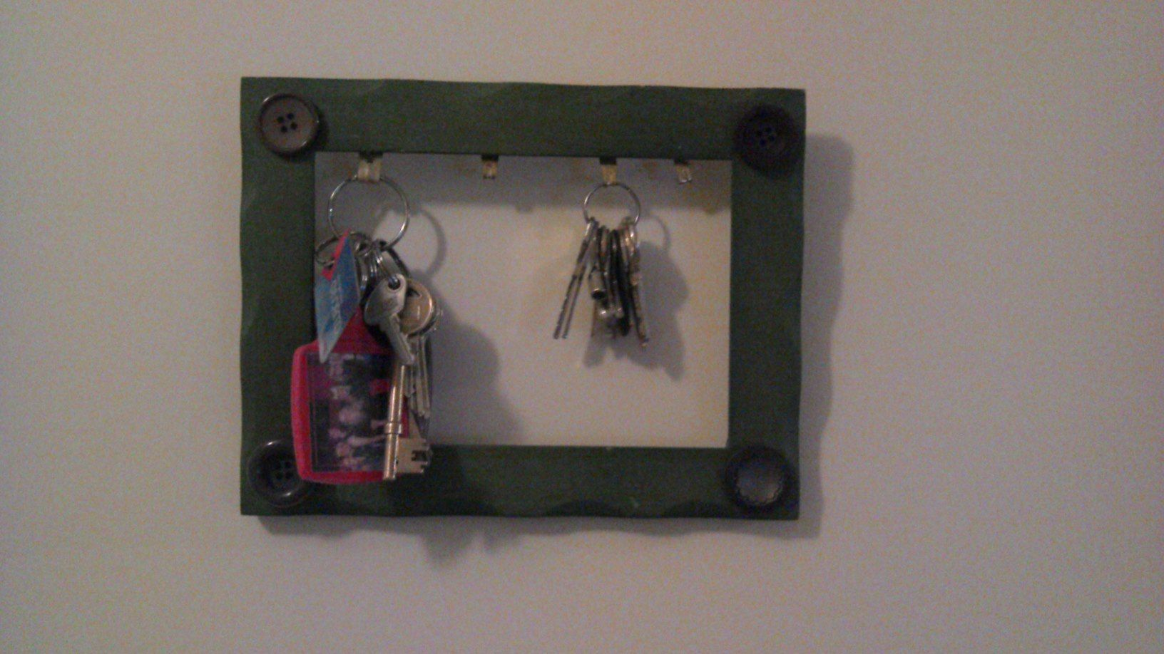 Homemade key holder old photo frame, buttons, pva glue