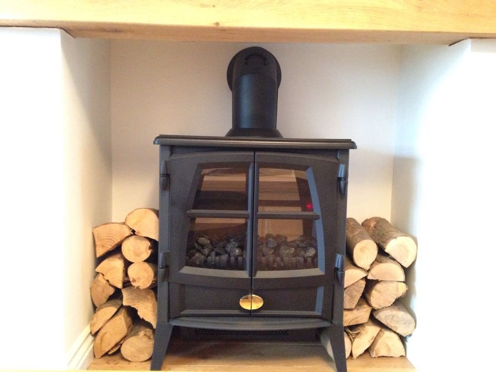 Electric log burner small spaces pinterest electric for Small den with fireplace