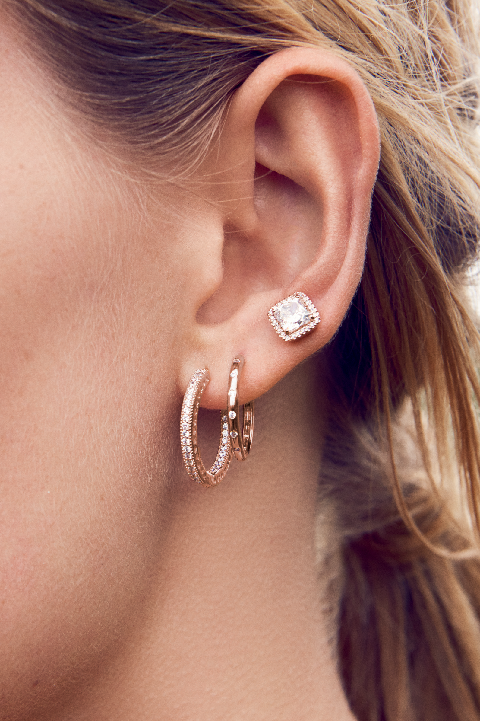 58cb9a608 Mix and match PANDORA Rose earrings for a classy look this season. Combine  hand-finished hoops and shimmering studs - the perfect day-to-night look!