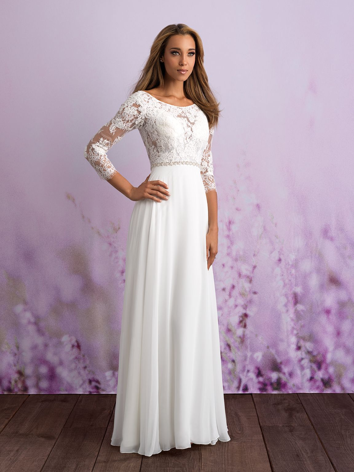 the lace bodice of this aline gown features a bateau neckline