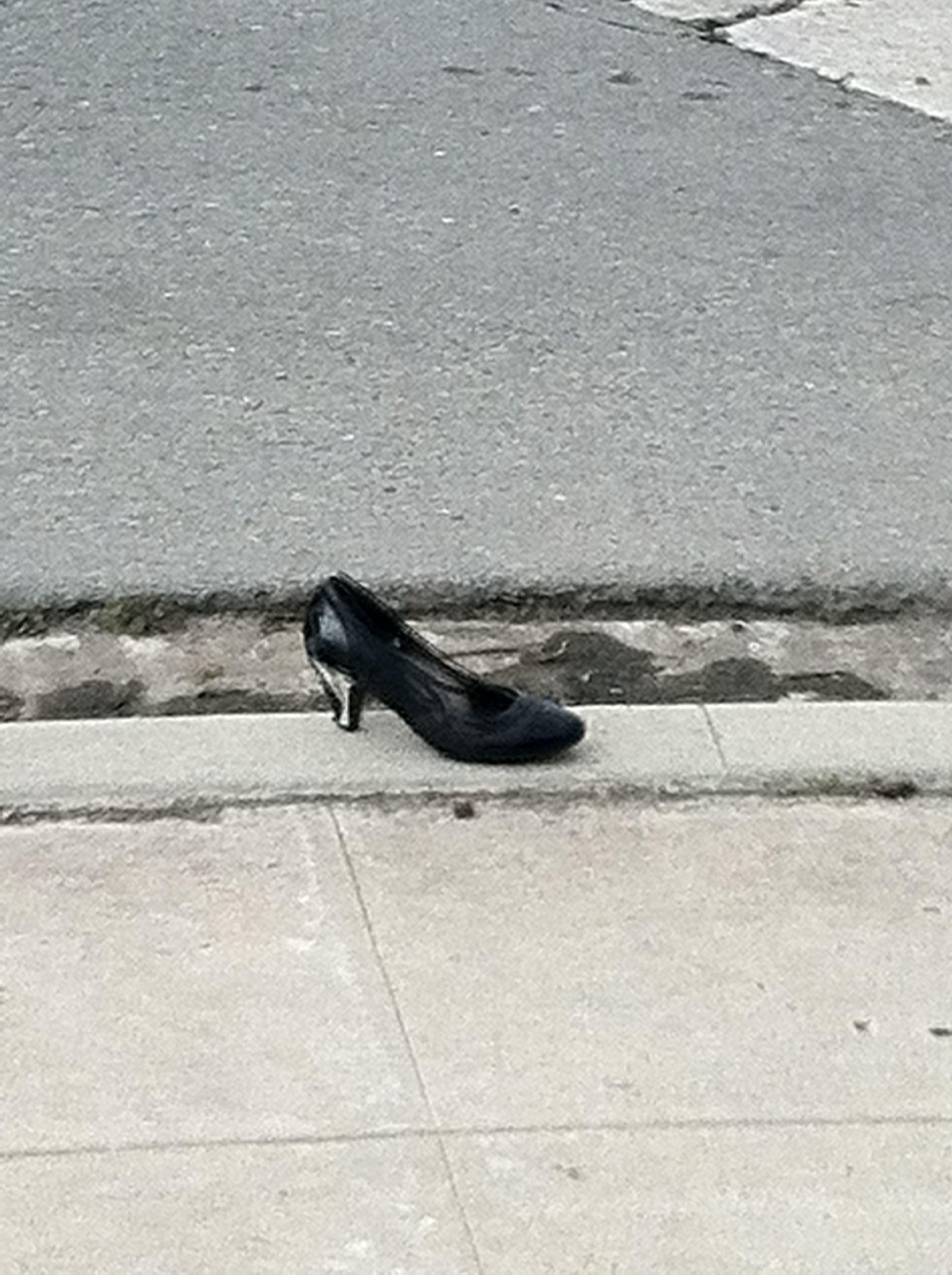 Random shoe on the curb