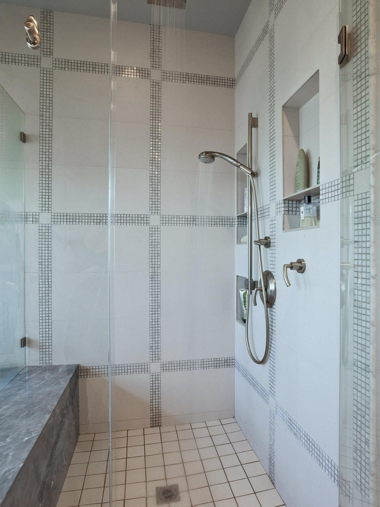 This simple but elegant modern bathroom shower features a rainshower ...