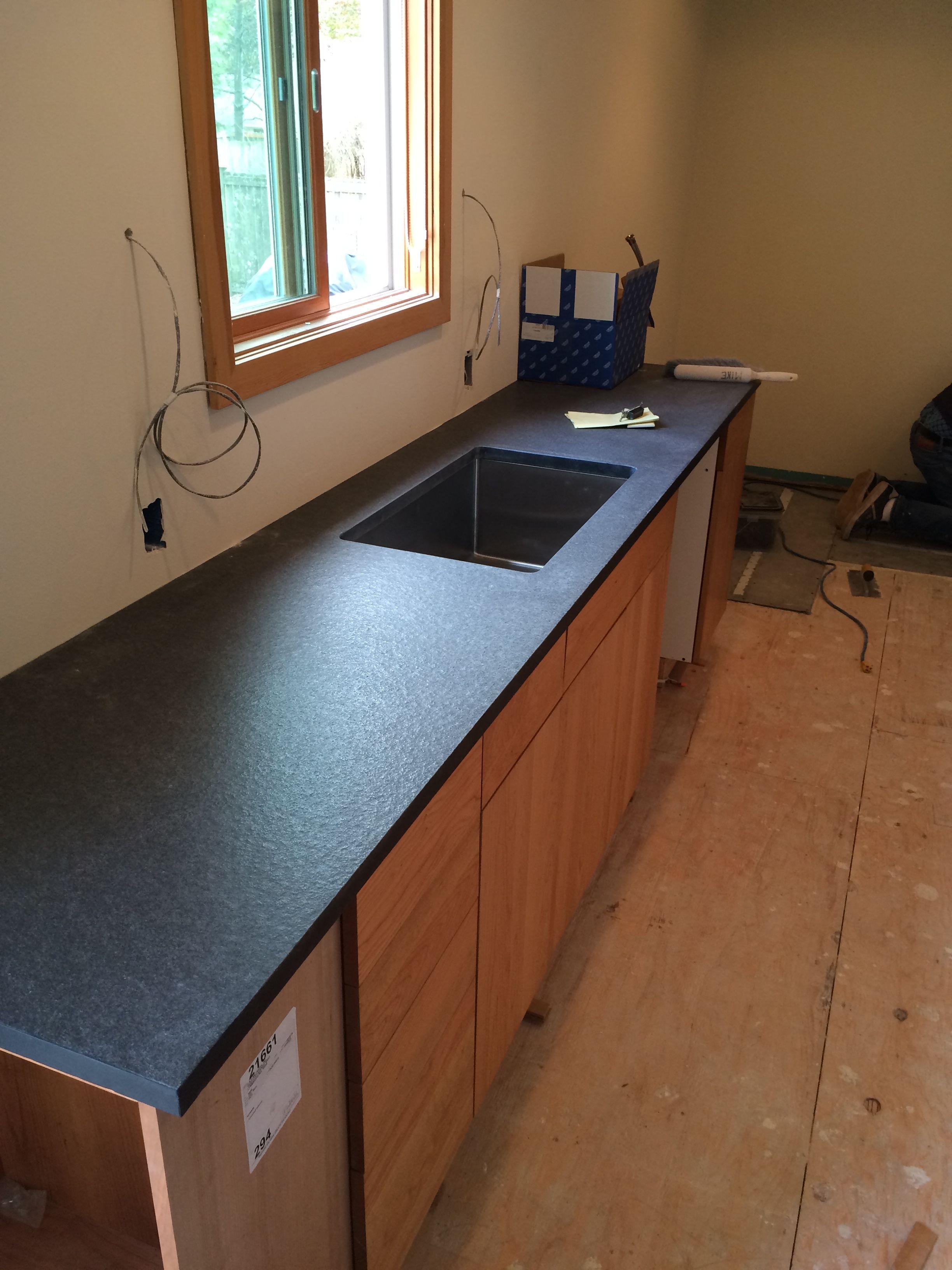 Absolute Black Granite In Anticado Leathered Finish Dewils Capella Cabinets In Natural C Granite Kitchen Island Leather Granite Granite Bathroom Countertops