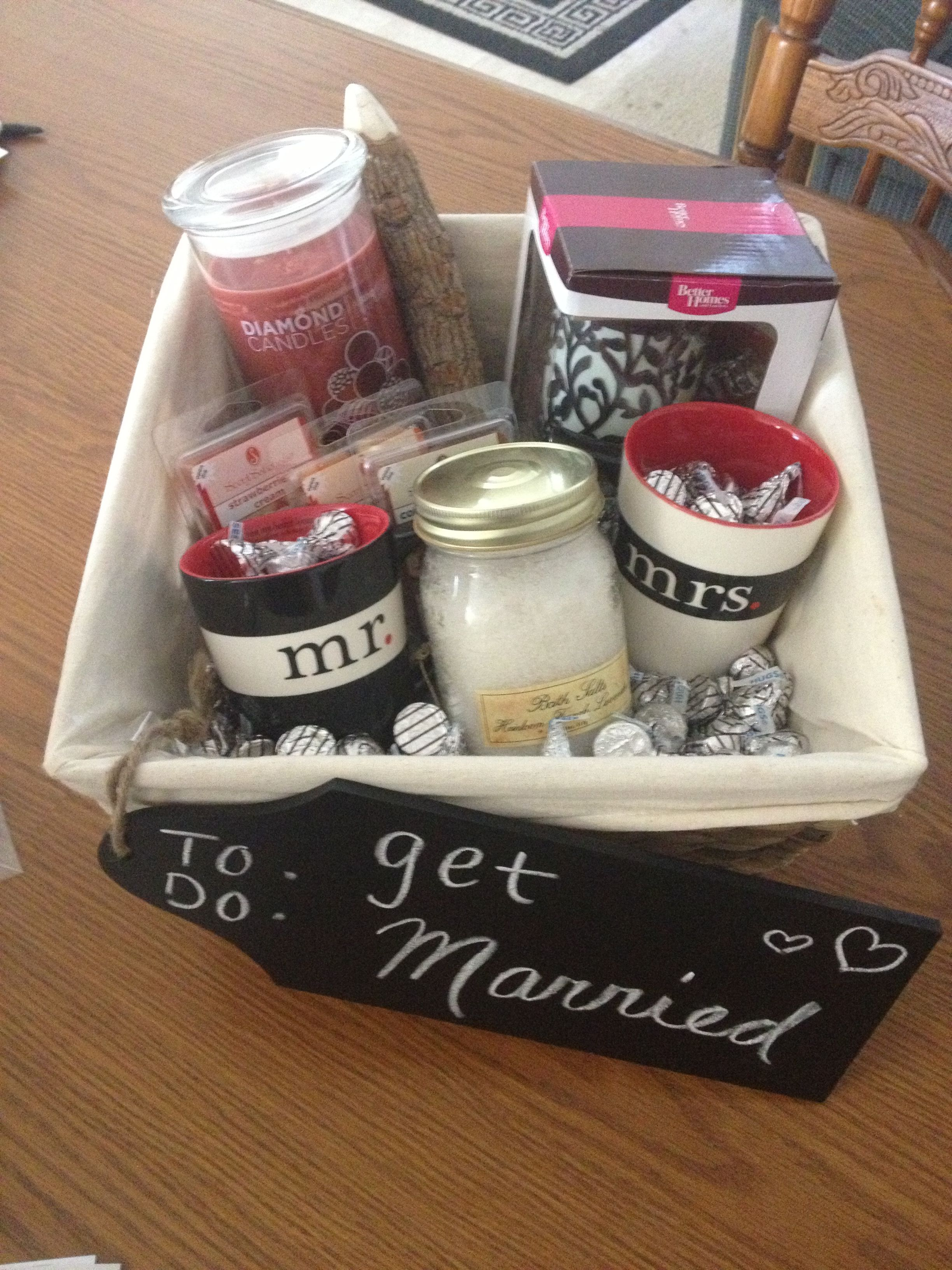 bridal shower gift basket for the bride you dont know too well or the couple that already have their home together smell good basket filled with kisses