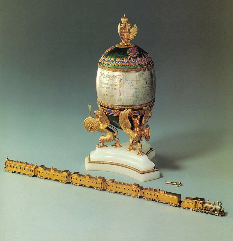 """Fabergé -- Trans-Siberian Railway Egg -- 1900 - Presented as a gift by Nicholas II to Empress Alexandra - Egg: Gold & Silver; Green, blue & orange enamel; Onyx & velvet lining - Train: Gold, platinum, rose-cut diamonds, rubies & rock crystal -- The silver egg with a hinged lid, a map of Russia engraved on the center section -- The """"surprise"""" is a working model of the train inserted into the egg, section by section. Belonging to the Kremlin Armoury Museum -- Moscow, Russia"""