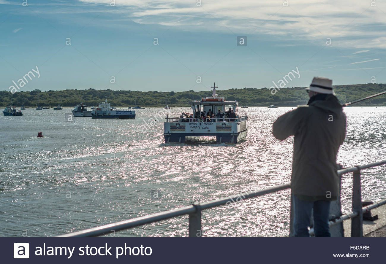 Download this stock image: Ferry heads towards Hengistbury Head at Christchurch Harbour, Christchurch, Dorset, UK. Taken on 29th September 2015. - F5DARB from Alamy's library of millions of high resolution stock photos, illustrations and vectors.
