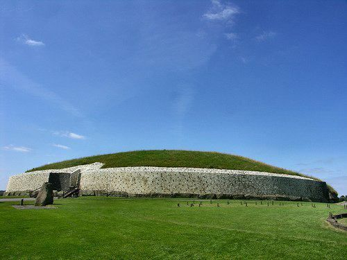 The Neolithic  passage tomb at Newgrange is the most visited archaeological site in Ireland. Over 5000 years old it pre-dates the first phase of Stonehenge by 1000 years and the Egyptian pyramids by 400 years. It is a truly massive structure measuring 76 m in diameter by 12 m in height and it contains over 200,000 tonnes of earth and stone in its fabric. Indeed, it's glistening façade of quartz is one of the country's most memorable vistas.
