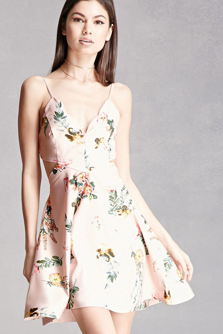A woven cami dress featuring an allover floral print, waist cutouts, scalloped sweetheart neckline with adjustable straps, a padded bust, back cutout, a fit-and-flare silhouette, and an exposed back zipper. This is an independent brand and not a Forever 21 branded item.