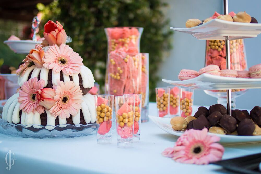Dessert bar for a 50th gold and coral birthday! The bundt