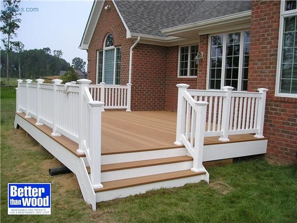 Love the deck style with white railings and composite decking.