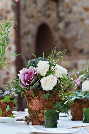 Rustic wedding centerpiece designed by Raining Roses