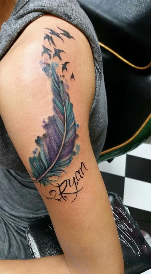 Feather Tattoo With Birds And Sons Name On Shoulder Blue Teal Purple And Pink Feather Tattoos Bird Shoulder Tattoos Feather Bird Tattoo Shoulder
