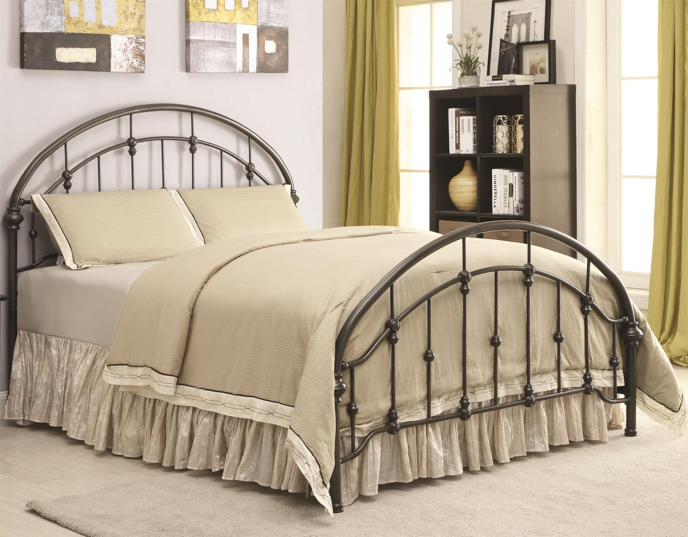 This metal bed has a dark bronzecolored curved headboard
