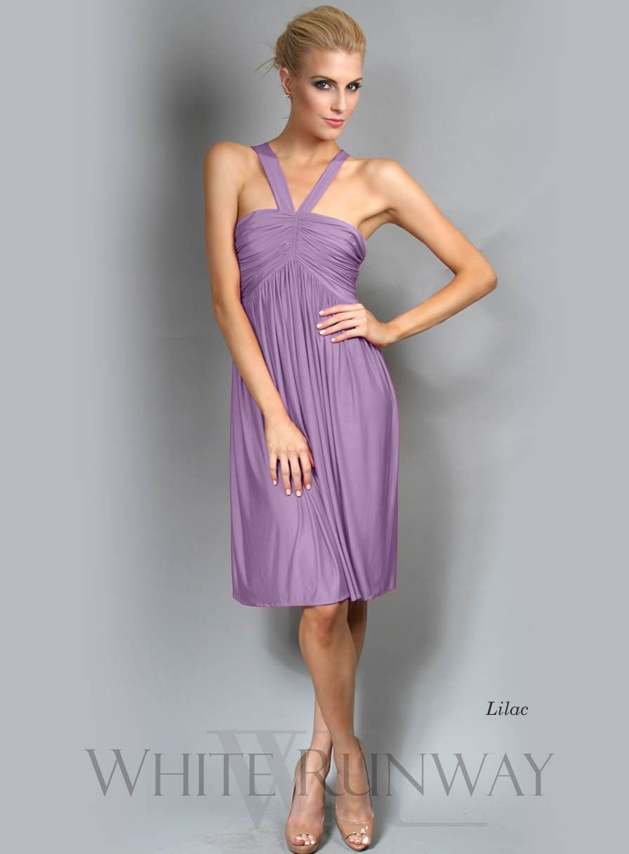 Beach wedding dresses for guest  The Elyssa Dress by Pia Gladys Perey features two straps crossing