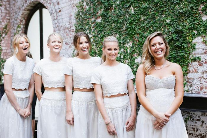 997fc425260 Unique bridal party outfits in white crop tops and maxi skirts. Alternative  bridesmaid style ideas that go beyond ...