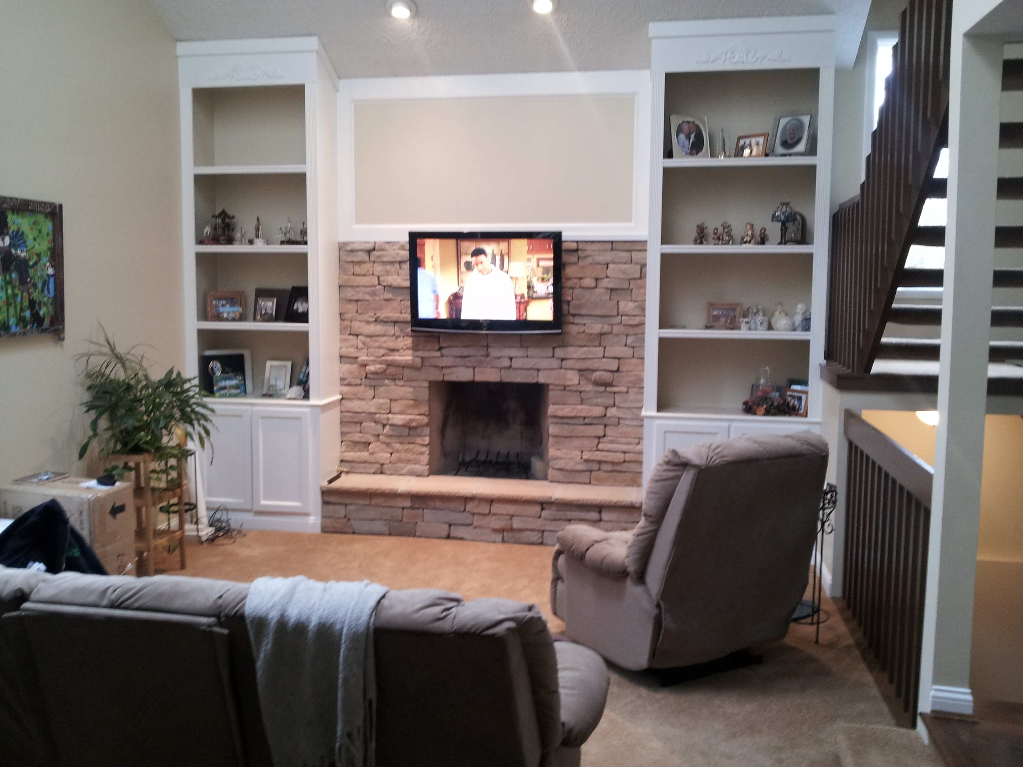 Tv On Stone Wall Over Fireplace All Wires Concealed To Components
