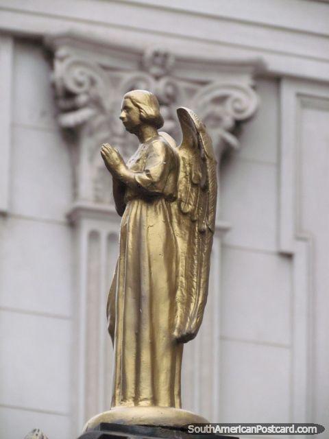 Golden angel figure at Basilica Nuestra Senora del Carmen in Santa Fe, Argentina.   (lbk)