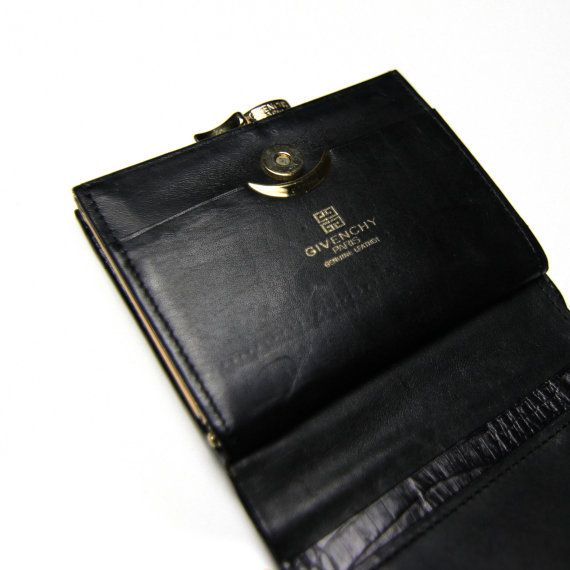 An authentic vintage Givenchy wallet, emulating what Givenchy does best.  Classy, simple, sophisticated. A truly timeless piece. 658fd6d1da