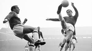Oct. 31st 1964, Manchester United's left-back Shay Brennan clears under pressure from Liverpool's Ian St. John at Old Trafford. United won 2-0.