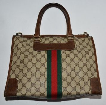 e222eeb7b5b Get one of the hottest styles of the season! The Gucci Brown Leather   Gg  Canvas Shoulder Bag is a top 10 member favorite on Tradesy.