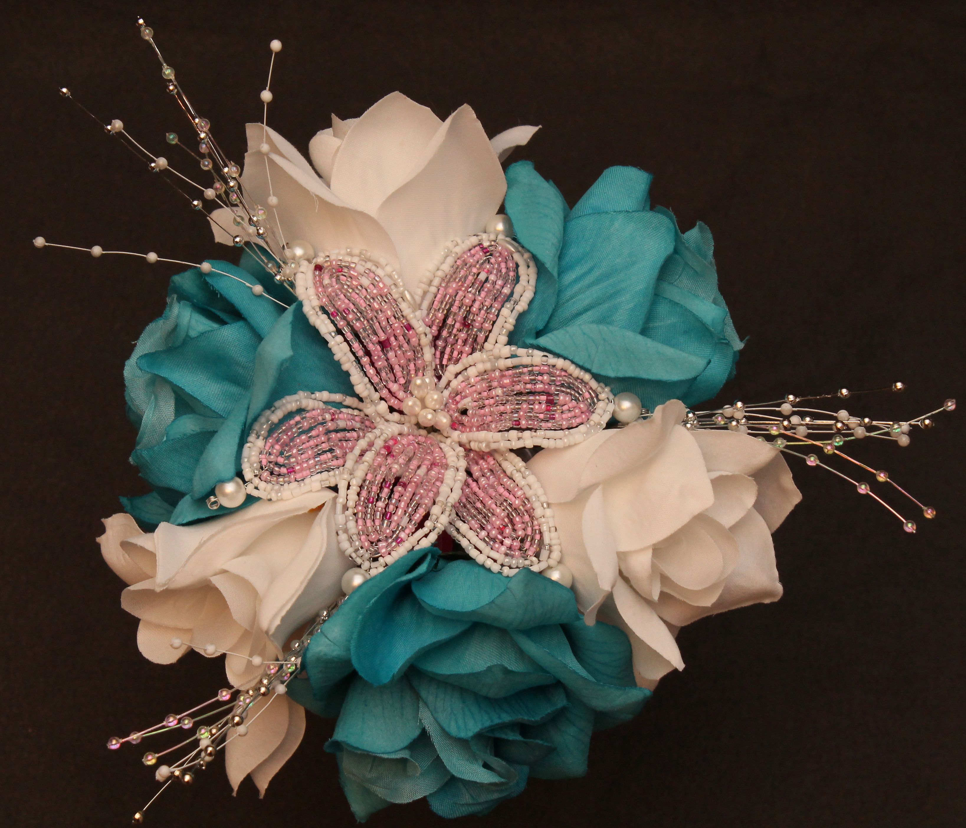 Light pink beaded flower on turquoise and white roses