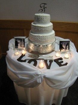 Cake Table Decor Simple Cute Couple Framed Photos Candles Flowers And Our Ini Wedding Cake Table Decorations Wedding Cake Table Cake Table Decorations
