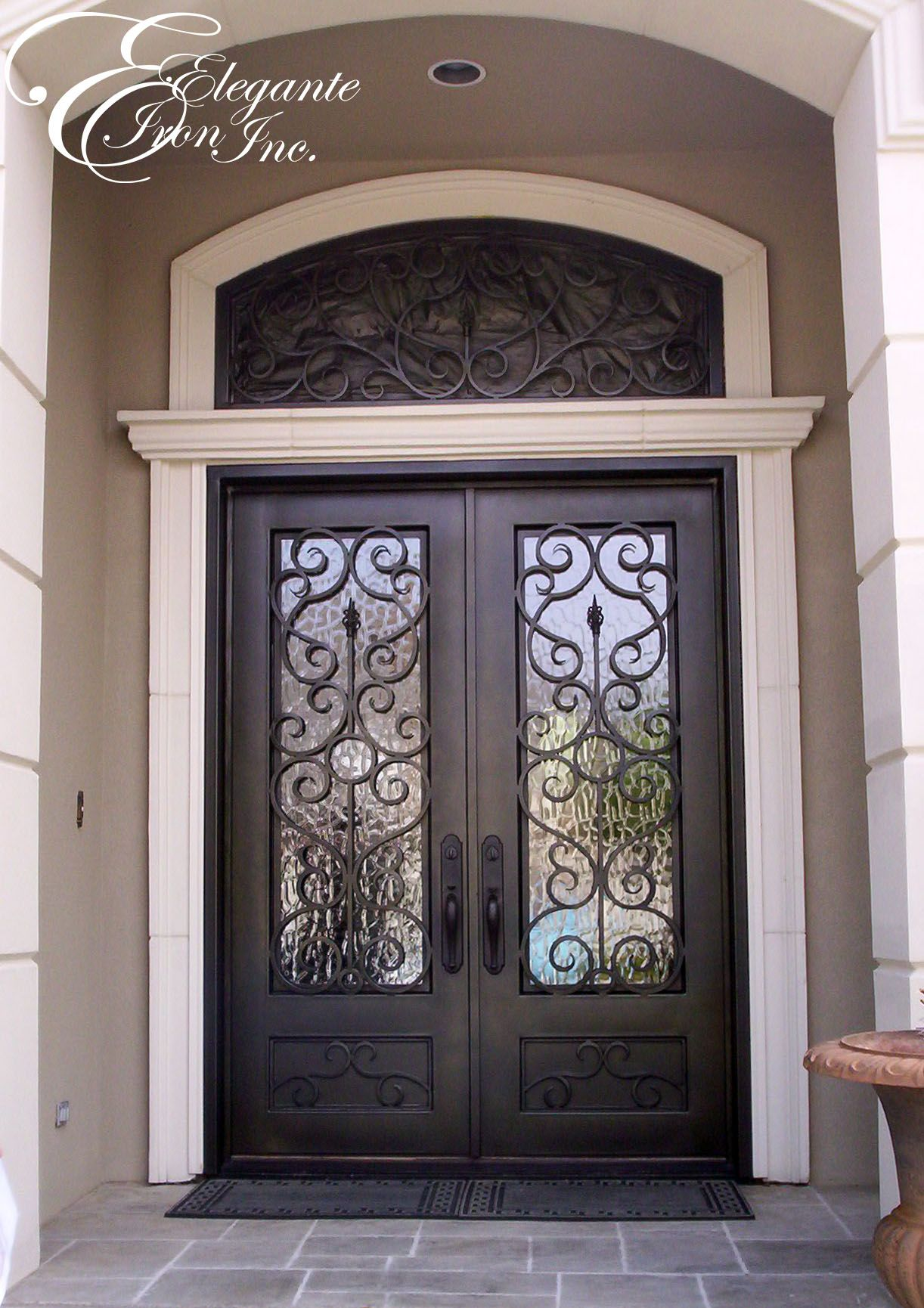 Custom wrought iron door with eyebrow arch transom for Exterior front entry double doors