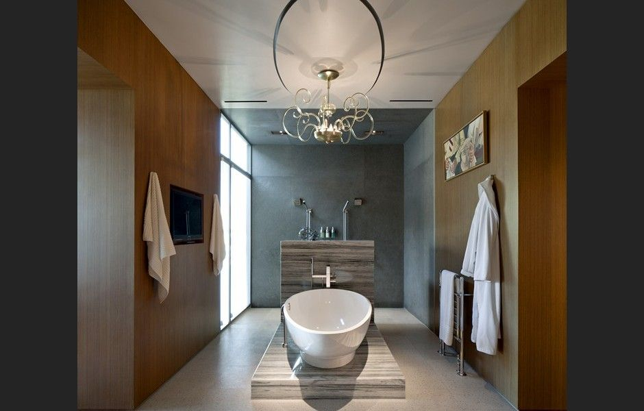 A soaking tub, a wall of glass and an open air shower ...