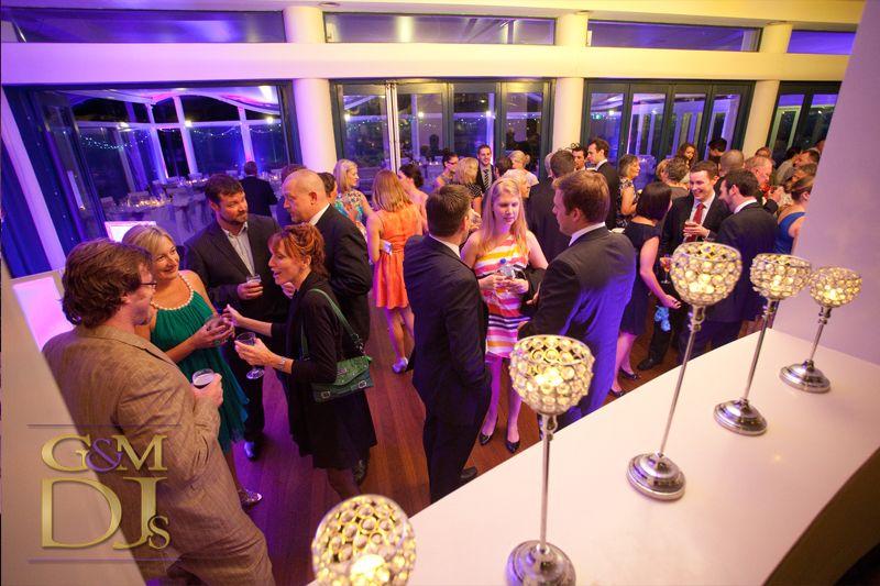 Wedding reception uplighting at the Landing at Dockside Brisbane by G&M DJs | Magnifique Wedding Lighting #gmdjs #magnifiqueweddings #lightingdesign #thelandingatdockside @gmdjs
