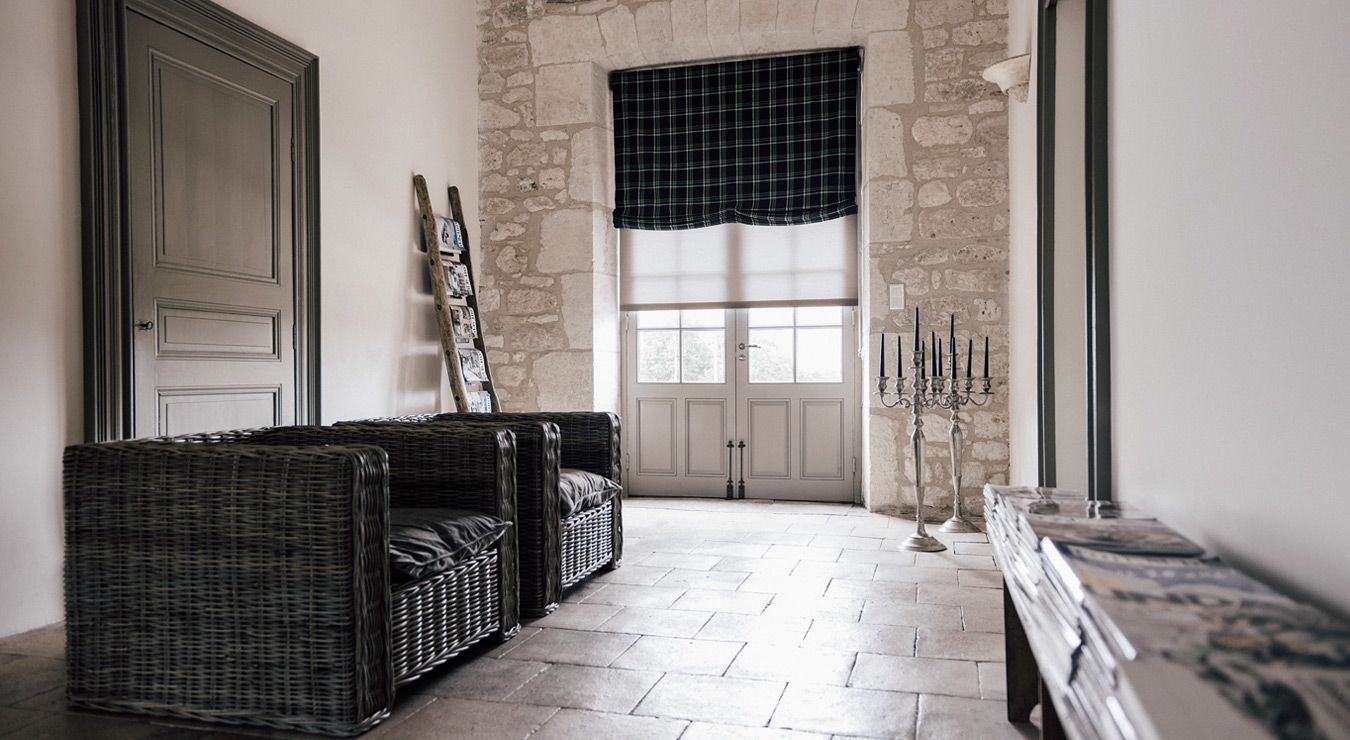 European window coverings  roller shades layered under relaxed roman shades add the right