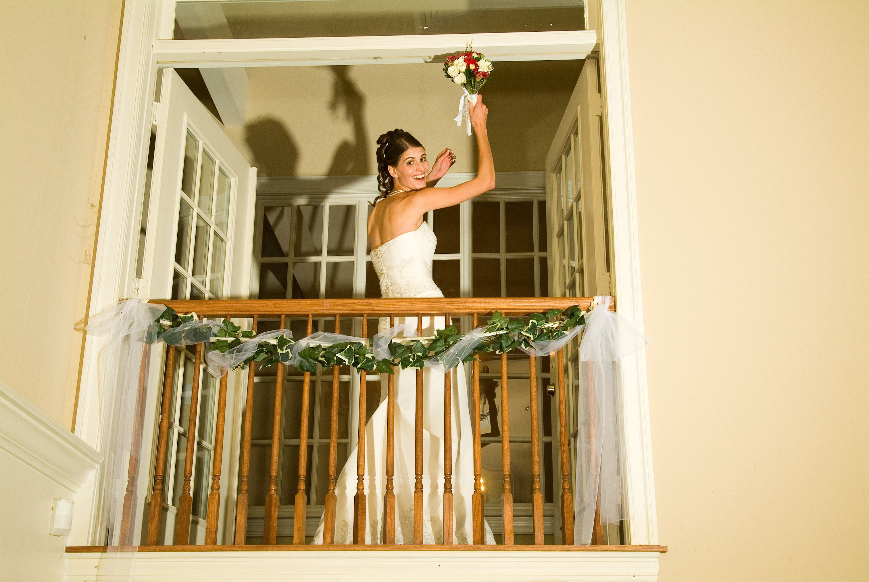 Bride throwing her bouquet from our Bridal Suite Balcony doors! These doors overlook the Ball Room!