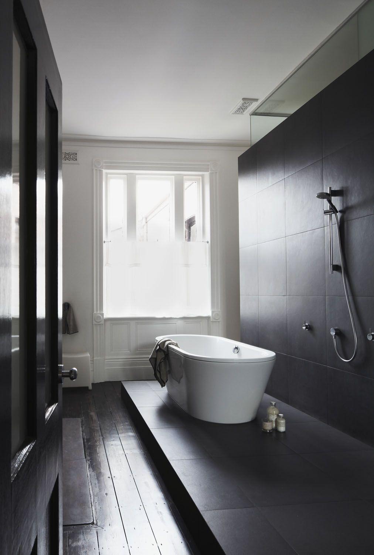 modern wet room in black & white, dark wood original floors, window ...