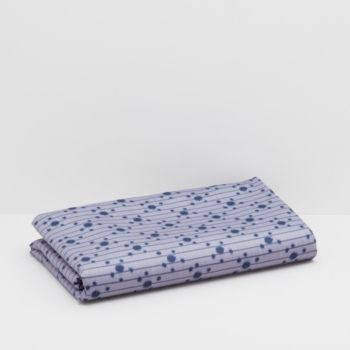 Inspired by the tranquility of nightfall, the Auchaud sheet is designed with floral blues and sapphire hues in a cotton sateen perfect for feeling soothed and protected as you rest.