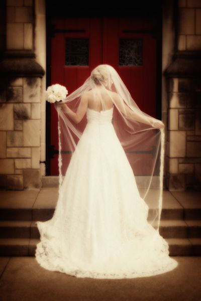 A soft chapel length veil makes this bride's look angelic