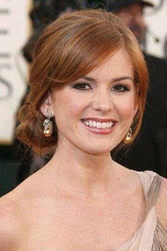 low side chignon | Isla Fisher\'s side bun - The top celebrity ...