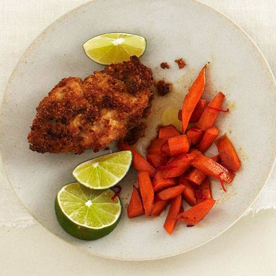 Hummus-Crusted Chicken with Chili Carrots | Homemade bean spread helps bread crumbs stick to chicken breasts. Serve the crunchy chicken with carrots tossed with olive oil, honey, and chili powder.