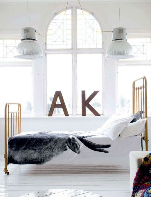There is soooo much I crave in this bedroom; the windows, the lamps, the bedding, the wooden letters. . .