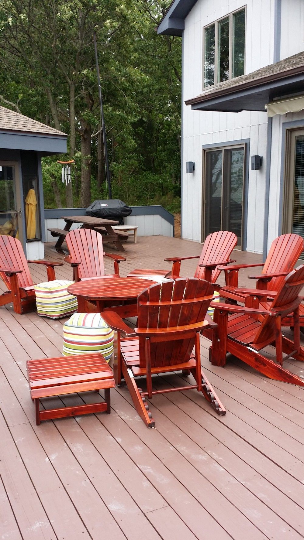 Knotted Cedar Reclining Adirondack Chairs Surrounding A 42 Coffee Table Are A Sure Way To Wooden Patio Chairs Wood Adirondack Chairs Adirondack Chairs Painted