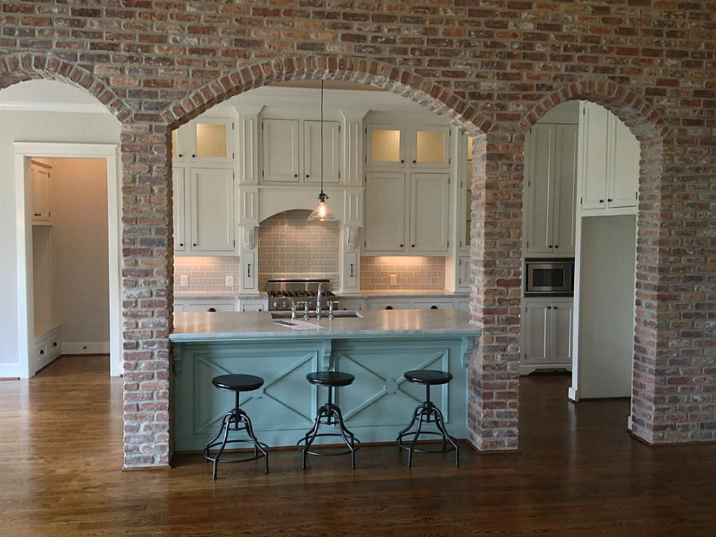 Love the exposed brick would definitely change the color for House inside arch design