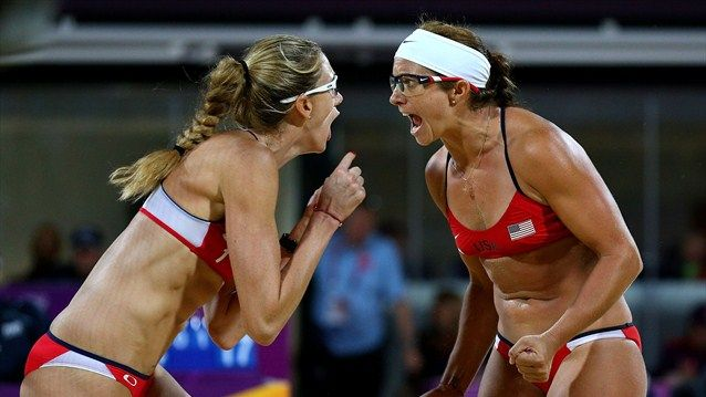 Kerri Walsh and Misty May-Treanor of the USA celebrate win to complete an Olympic golden hat-trick. In an all USA final the two-time defending champions defeated Jennifer Kessy and April Ross in straight sets. The final score was 21-16, 21-16. Brazil's reigning world champions Larissa Franca and Juliana Silva won bronze after they came from behind to beat Chinese pairing of Xue Chen and Zhang Xi. - London 2012 Olympics