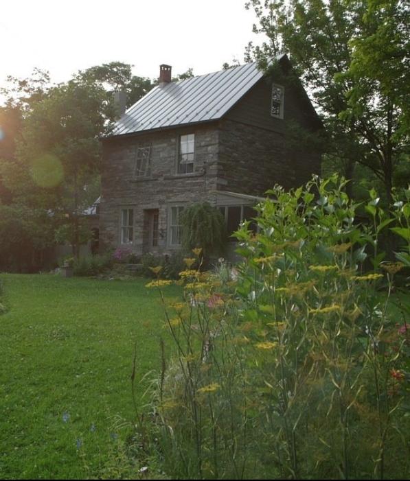 STONE HOUSE with dark grey porch & siding