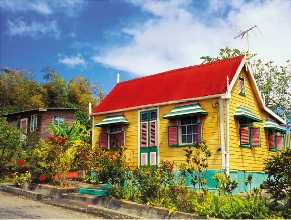 Brilliant chattel house from Barbados in an array of bright Caribbean colors showing personality and a confidently cheerful spirit.