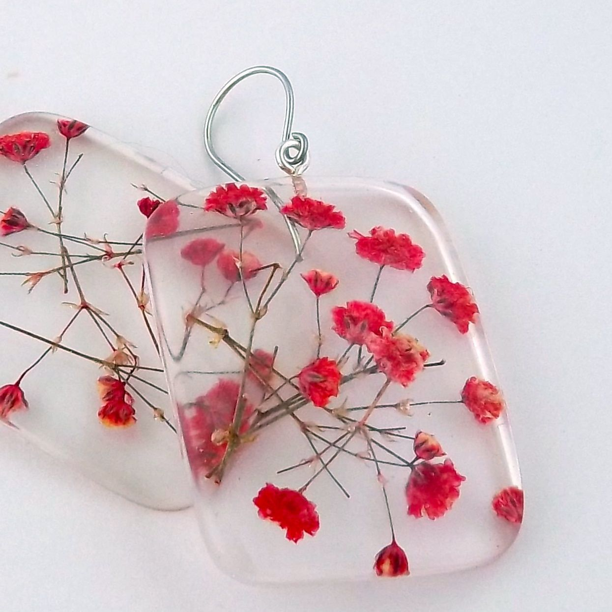 Earrings | Summer Smith. Pressed red baby's breath that are encased in resin, with sterling silver ear wires.